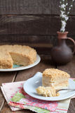 Classic Cake Napoleon of puff pastry with custard cream on a pla Royalty Free Stock Images