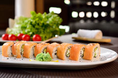 Classic California rolls in the restaurant supply. Royalty Free Stock Images