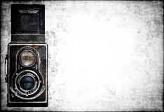 Classic camera on a grunge background Royalty Free Stock Images
