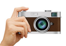 Classic Camera in hand on white Stock Images