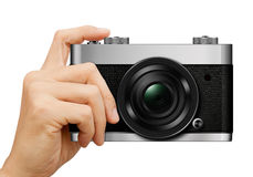 Classic Camera in hand on white Royalty Free Stock Photography