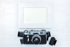 Classic camera with negative films and empty photo frame on whit Royalty Free Stock Photos