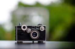 Classic camera Put on the table does not look expensive. Photography Ideas and Old Camera Care royalty free stock photo