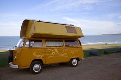 Classic camper van. A classic yellow camper van parked in North Devon The artwork on the van is my own Stock Photos