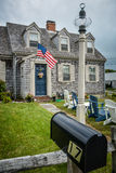 Classic Cape Cod house with Stars and Stripes Stock Image