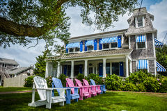 Classic Cape Cod house with sunchairs lined up Stock Photos