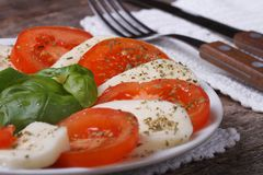 Classic caprese salad  on an old wooden table. close up Stock Images