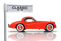 Classic Car. Reflecting On The Streets Of Yesteryear � Red Jaguar Classic Car Royalty Free Stock Photography