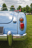 Classic car. Blue, classic car, MG, tail lights and a bumper royalty free stock photo