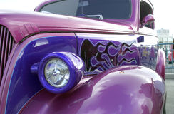Classic car. Front view of a purple classic car Royalty Free Stock Image