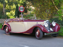A classic car. Wealthy visitors. A classic car parked in the village Royalty Free Stock Image