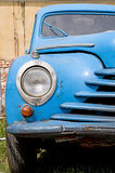 Classic car. Front view of a blue classic car from 1950s - 1960s abandoned in the scrapyard. Vintage means of transportation Royalty Free Stock Photo