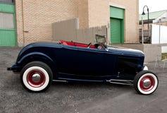 Classic car. On warehouse lot Stock Photos
