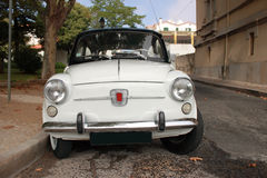 Classic car. Old white Fiat 500 in a street Stock Photos