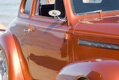 Classic Car. Antique car with beautiful orange sunburst paint Royalty Free Stock Photos