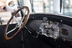 Classic car. Interior of a classic car with wooden steeringwheel stock photo