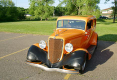 Classic Car. An orange and black hot rod Royalty Free Stock Photography