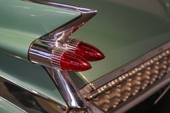 Classic car. Tail lights of a classic American car stock images