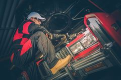 Ambitious Car Mechanic. Classic Car Ambitious Mechanic in Front of the Classic Car Big Block Engine Royalty Free Stock Images