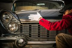 Classic Car Appraisal. American Classic Car Appraisal. Professional Worker Looking For Damages on the Vehicle Royalty Free Stock Images
