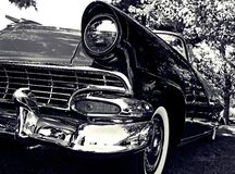 Classic Car - Black and White. Image of a beautiful classic car with shiny chrome, done in black and white Royalty Free Stock Image