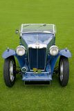 Classic car, blue soft top. Vintage classic soft top sports car, after a rainfall royalty free stock photography