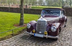 Classic car in castle courtyard. Classic car in Nordkirchen castle courtyard stock photos
