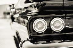 Classic car tail lights close-up. Classic car with chrome parts tail lights close-up stock photos