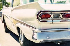 Classic car tail lights close-up. Classic car with chrome parts tail lights close-up stock image