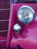 Classic Car Closeup. Close up of headlight and grill of antique hot pink car Stock Photography