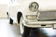 Classic car with closeup on headlights. Vintage vehicle front detail Royalty Free Stock Images