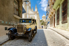 Classic car in a cobblestone street in Old Havana Stock Photography