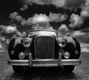 Classic car on cobblestones Royalty Free Stock Images