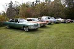 Classic car collection. A row of antique cars on a collector`s property outside stock images