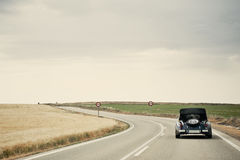 Classic Car in a Country Road Royalty Free Stock Photography