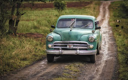 Classic Car, Country Road, Vinales, Cuba. A green vintage car on a back country road in the agricultural area of Vinales, Cuba Royalty Free Stock Photography