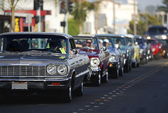 Classic Car Cruising 2. A line up of classic old cars cruising the local strip Royalty Free Stock Photography