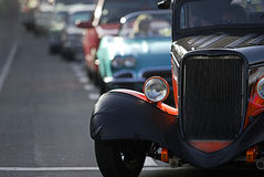 Classic Car Cruising. A line up of classic old cars cruising the local strip Stock Photos