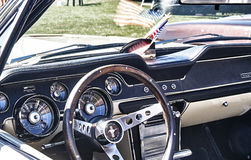 Classic car dashboard in black and cream royalty free stock image