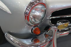 Classic shiny car details. Old-timer front lights and chrome detail Stock Image