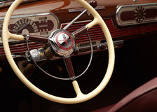 Classic car dashboard and steering wheel Royalty Free Stock Images