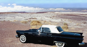 Classic car in desert. Classic black ford thunderbird in the painted desert, arizona,us Stock Images