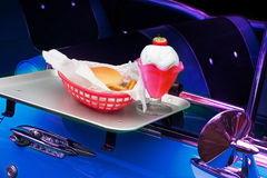 Classic car in Drive-In. Classic car in drive in with burger and milk shake Royalty Free Stock Photography