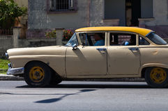 A classic car driver on the street in havana city Stock Images
