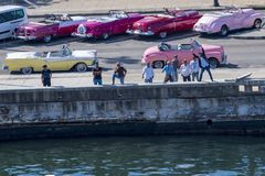 Classic car driver welcome tourists in Havana, Cuba Royalty Free Stock Photography