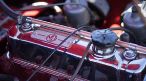 Classic car engine. Close up view of a classic MG car engine with chrome plated parts. Photo taken on: July 27, 2014 Royalty Free Stock Photo
