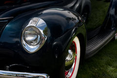 Classic car fender. Front of a vintage car with headlight and fender Stock Image