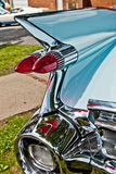 Classic Car Fin. Classic car vintage tail lights and rear chrome bumper royalty free stock photos
