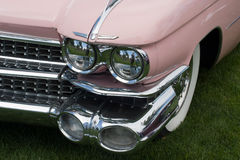 Classic car front. Front of a pink classic car with headlight and fender Royalty Free Stock Photos