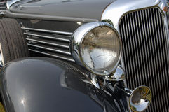 Classic Car Front. Gray classic car seen from front, grill and headlight and fender royalty free stock photos